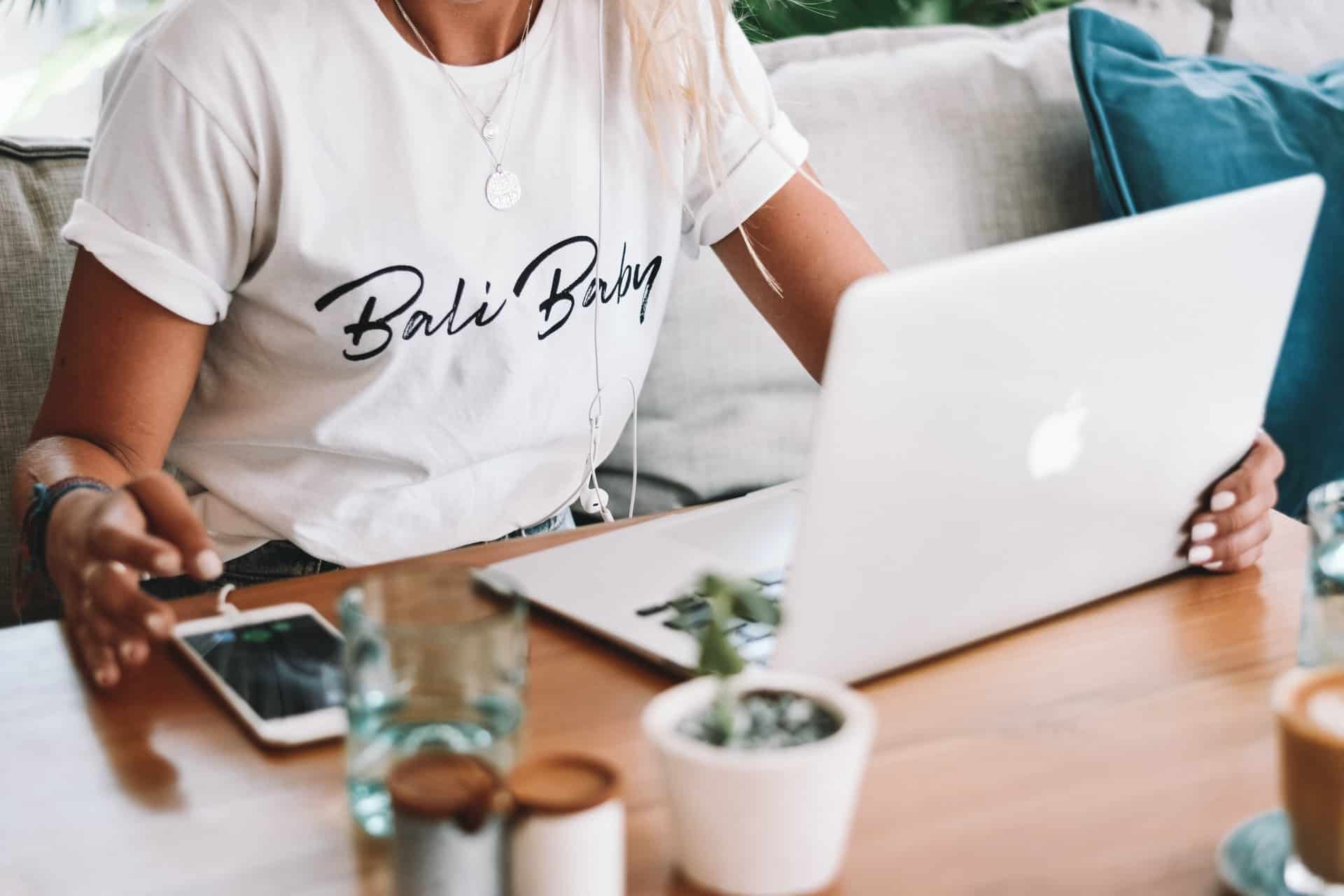 Woman in White shirt Text Bali Baby sitting at desk