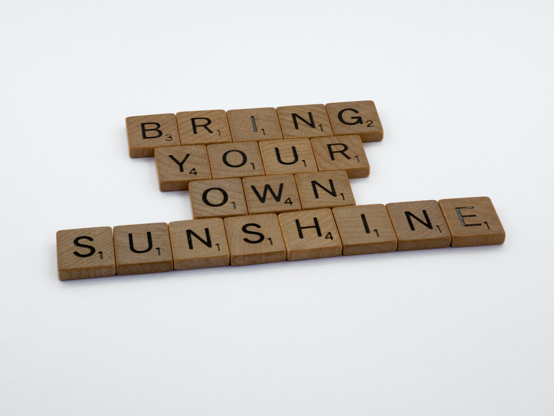 brown scrabble letters bring your own sunshine white background